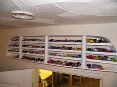 Old vehicle grill used as a display for Hot Wheels
