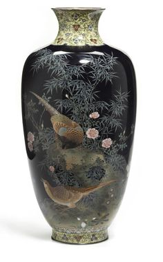 A fine cloisonne enamel vase By the workshop of Hayashi Kodenji (1831-1915), late 19th century Of elongated ovoid form and worked in gold and silver wire on a dark blue ground with pairs of birds in a flowering landscape in multicolored enamels above a floral lappet band, the yellow ground foliate-patterned collar defining the neck repeated on the circular foot, with silver rims, the base with the lozenge-shaped studio mark and signed Aichi Hayashi saku