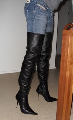 Amateur in black thigh boots and jeans