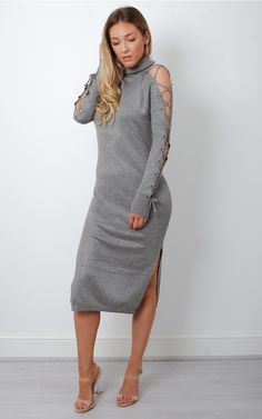 Soft and sexy, this roll neck lace up sleeved bodycon dress will fit perfectly into your AW wardrobe.