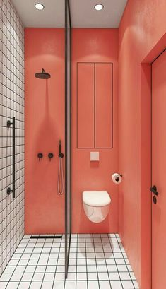 coral walls contrast white tiles with black grout to make up a bold and unusual bathroom