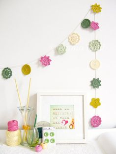 Yvonne crochet flower garland in cute Kawaii colours, spring home decor in pink, green & yellow - ready To Ship, by Emma Lamb