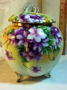 Antique Nippon Hand Painted Cherry Blossom & Gilt Footed Biscuit Jar with Lid (I'd have to say they're violets as opposed to cherry blossoms, but this is the original description.)
