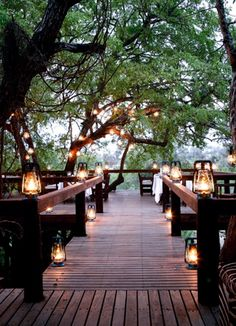 Dreaming of creating our outside deck... full of romantic candles and giant oak trees.