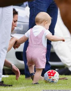 Prince George plays mini football with mum...cute!