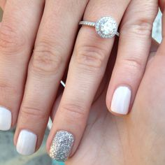 Round engagement ring. Beautiful! And I love these wedding day nails!