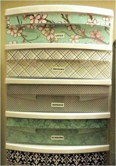 Makeover Plastic Bins with just scrapbook paper and spray adhesive.
