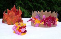 Crowns from nature walk.  Paper bag, leaves, etc.