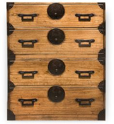 Love this accent piece!  This elegant tansu chest is comprised of two separate pieces handcrafted out of the light yet sturdy Kiri wood, long cultivated in its native Japan for its light weight, strength and resiliency. Kiri's dramatic grain and unstained beauty are accented by hand-forged iron hardware