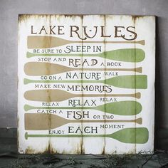 Here's what's on your summertime lake retreat agenda: sleep in, read a book, and follow the instructions on this rustic plaque.
