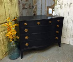 This is a vintage, Federal Style, Mahogany dresser with 6 drawers and serpentine front. The middle drawer has special compartments to store cuff