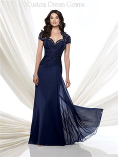 Sophisticated Lace & Chiffon A-Line Gown with a Queen Anne Lace Sweetheart Neckline, Lace Short Sleeves, Beaded Lace Fitted Bodice with a Dropped Waistline, Side Draped Chiffon A-Line Skirt, Brush Train, Illusion Lace Keyhole Back with Hidden Zipper Closure. #beautifulmotherofthebride #custommotherofthebride #eveninggown #lacemotherofthebride #chiffonmotherofthebride #specialoccasiondress #weddingattire #alinemotherofthebride #customgown #customdress #fashion #dress