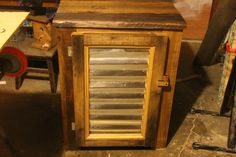Rustic looking cabinet. Just some old oak and corrugated metal.