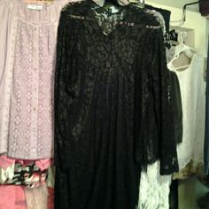 Black soft lace dress This beautiful dress full of lace and built in slip curves to ur body. Stretch material. New never worn. Dresses Long Sleeve