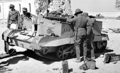 Captured British Bren Gun Carrier.bmp  Judging by the uniforms , the German soldiers belong to the Afrika Korps. North Africa,
