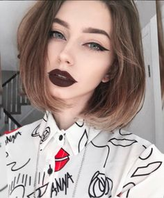 graphic eyeliner and dark purple lips