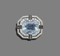 An art deco aquamarine, onyx and diamond brooch/pendant, circa 1925. The large step mixed-cut aquamarine, centrally-set within two cushion-shaped, single and brilliant-cut diamond borders, highlighted with duos of calibré-cut onyx at each cardinal point, millegrain-setting throughout