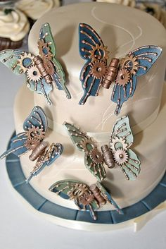Steampunk butterflies on a cake! I really wish I had seen this before our wedding. Maybe when/if we renew our vows one of you awesome cake people can do this for me :)