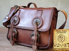 Handmade notebook bag with leather lacing.