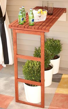 DIY fold away table  --This would be great for activities that are occasional, like grilling and potting plants