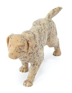 A RUSSIAN CARVED HARDSTONE FIGURE OF A DOG, CIRCA 1900 modeled as a hunting dog stalking prey, with collet-set diamond eyes, the underside of one paw with an obscured initial or monogram