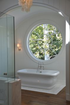 White bath with a unique round window. Dream Bathrooms, Beautiful Bathrooms, Luxury Bathrooms, Master Bathrooms, All White Bathroom, White Bathrooms, Decor Scandinavian, Bathroom Windows, Bath Window