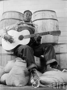 37cfa98c604 Bonus Pin American manhood in Black and White  Huddie Williams Ledbetter  known as Lead Belly was an American folk and blues musician and he  introduced the ...