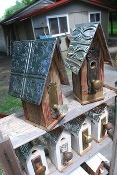 Antique doorknob birdhouses.  Cute idea with antique odds and ends!