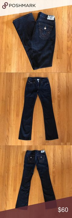 """True Religion Bootcut Flap Pocket Jeans Dark rinse 5-pocket construction with button flap pockets, contrast stitching, and shiny, copper metallic stitched """"horseshoe"""" on back pockets. Flap closure on front coin pocket. Zip fly with silver button closure. Hi-rise bootcut style. 98% cotton and 2% spandex. 8"""" rise. 34"""" inseam. Excellent, like-new condition. True Religion Jeans Boot Cut"""