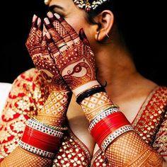 Hands covered in bridal mehendi design and the groom's name. Wedding Chura, Goa Wedding, Punjabi Wedding, Desi Wedding, Wedding Shoot, Wedding Bride, Indian Mehendi, Bridal Chuda, Bridal Bangles