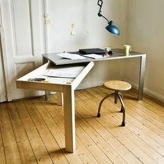 Designer Stephan Schulz Top-Loader desk hides a unique secret feature that gives the smaller workspace an expansive presence.