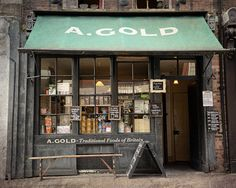 A. GOLD SHOP, LONDON A traditional British food specialty shop located in the Spitalfields area of London. The building dates from the 1780's and takes its name from Amelia Gold who ran her French millinery business on the site in the 1880's.