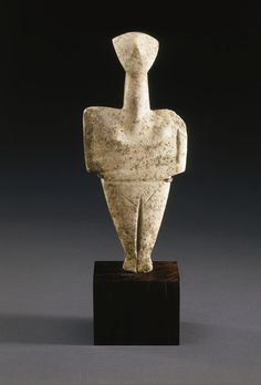 A CYCLADIC MARBLE FEMALE FIGURE   chalandriani variety, early cycladic ii, circa 2300-2200 b.c.   Sculpted with a small triangular head tilted slightly backward and a long bulging neck, the broad shoulders upward sloping, the arms bent sharply at the elbows, the right arm above the left and directed more diagonally across the mid-riff, with the right hand resting just below the left breast, the legs together with the feet angled down, a narrow cleft extending from the pubic triangle to the…