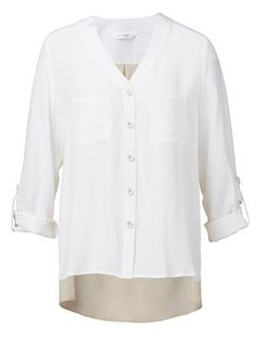100% Silk shirt. Comfortable silhouette, features contrast colour on back body. Long sleeves with sleeve shortening tab. Available in White as shown.
