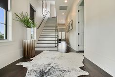 cow hide rug Staircase Contemporary with animal hide rug black