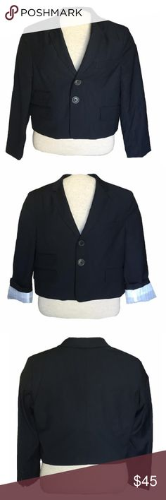 Anthro Troy Smith Cropped Navy Blazer 🎁FREE GIFT when you bundle 2 or more items!!!🎁  NWT Troy Smith for D Collection navy blazer, from Anthropologie. Cropped style. 2-button closure. Notched collar. Multiple flap pockets (sewn shut) at front hips. Slit at rear. Fully lined with a cut pinstripe cotton blend lining. Top stitching details on interior and along pockets and lapel. 4 buttons at wrists. Shell is poly/rayon blend. Machine washable. Size M. Excellent addition to your work wardrobe…