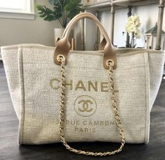 2018 Chanel deauville tote in beige. Everything in my photos will be included. - 2018 Chanel deauville tote in beige. Everything in my photos will be included. Burberry Handbags, Chanel Handbags, Purses And Handbags, Leather Handbags, Chanel Tote Bag, Luxury Bags, Luxury Handbags, Designer Handbags, Fashion Bags