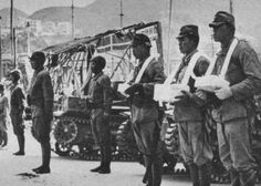 army tank crews carrying the ashes of his fallen comrades after the battle of hong kong in december 1941