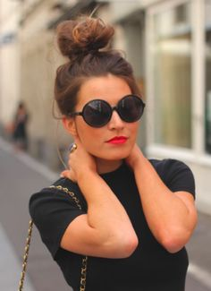 high bun. round shades. red lips. fabulous.