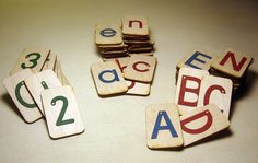 montessori mini sand paper letters and numbers set on birch wood.