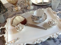 pinned to remind me to paint some old metal trays white for dresser tops Vintage Accessories, Wedding Accessories, Metal Trays, Wedding Rentals, Vintage Metal, High Gloss, Cup And Saucer, Mirrors, Tea Cups