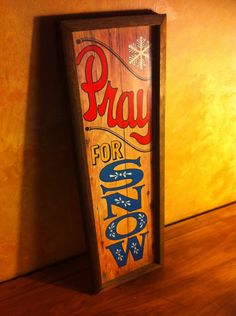 Vintage 'Pray for snow' timber sign