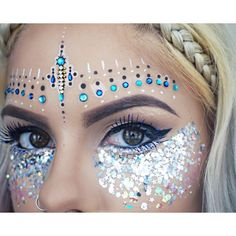 ✨ Look a fleek of nature ✨ in our 'In Your Dreams Face Jewels'! The perfect … ✨ Look a fleek of nature ✨ in our 'In Your Dreams Face Jewels'! The perfect festival makeup Glitter Face Festival, Blue Festival Makeup, Face Gems, Face Jewels, Coachella Makeup, Festival Make Up, Dramatic Wedding Makeup, Blue Mascara, Rave Makeup