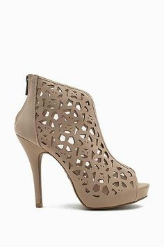d2bce7b69e6 Stand out and stand tall at the party in these lovely nude booties!  Features a flirty peep toe