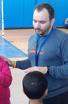 John Teves - Director of Sidekick Soccer Academy's Kids Kick with Care — at Winter Hill Community School.