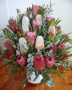 Native church flowers with pink ice proteas, banksia menziesii, banksia burdettii and devils blush Leucadendrons, by RANE flowers Australian Native Flowers, Australian Garden, Flowers In Hair, Pink Flowers, Pink Flower Arrangements, Protea Flower, Kangaroo Paw, Ice Plant, Church Flowers