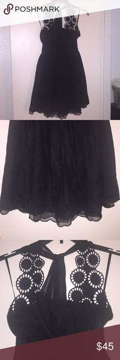 Black cotton halter dress size small amazing!! I can't even to begin to tell you how amazing this is it cotton with a sheer petticoat that shows slightly at the bottom the front is crochet and the halter is a pretty sheer chiffon so unique purchased at a boutique in NYC for 99$ to wear to a wedding worn one time thanks for looking!! black Dresses Mini