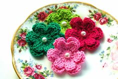 Crochet flowers with a pearl:)