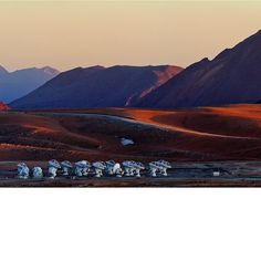 This panoramic view of the Chajnantor Plateau shows the site of the Atacama Large Millimeter/submillimeter Array (ALMA), taken from near the peak of Cerro Chico. Babak Tafreshi, an ESO Photo Ambassador, has succeeded in capturing the feeling of solitude experienced at the ALMA site, 5000 metres above sea level in the Chilean #Andes. Light and shadow paint the #landscape, enhancing the otherworldly appearance of the terrain. In the foreground of the image, clustered #ALMA #antennas look like…