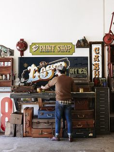 Melbourne-based sign painter TJ Guzzardi in his Tullamarine workshop. Photo by Eve Wilson for thedesignfiles.net